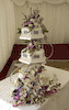 Derbyshire CHOCOLATE WEDDING CAKES Derbyshire Three tier hexagonal fondant Derby wedding cake Derby with fresh flower Derbyshire wedding cake toppers. Tasty Treats Nottingham Derby Wedding Cake Maker Derby
