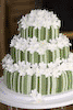 Derby CHOCOLATE WEDDING CAKES Derby Three tiered green stripy (stripey, stripped, striped) stacked derby wedding cake derby with individually handmade iced flowers. Each tier was made in a different flavour Carrot Cake, Fruit Cake and Chocolate Cake in order to provide the guests with a choice. Tasty Treats Nottingham Derby Wedding Cake Maker Derby